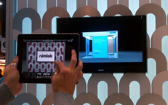Example of virtual reality building an exhibit on an ipad to entice trade show attendees