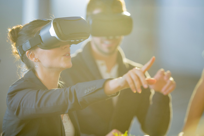 image of people using virtual reality to entice trade show attendees