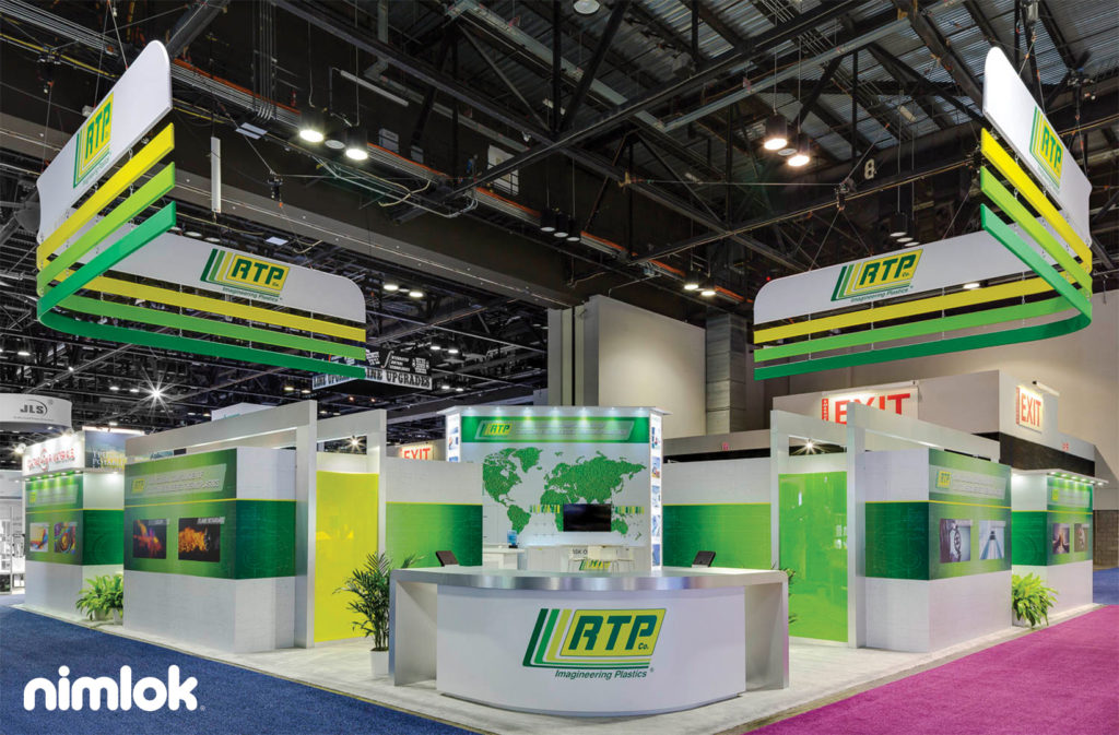 50'x50' island exhibit with custom hanging structures and brand-forward graphics.