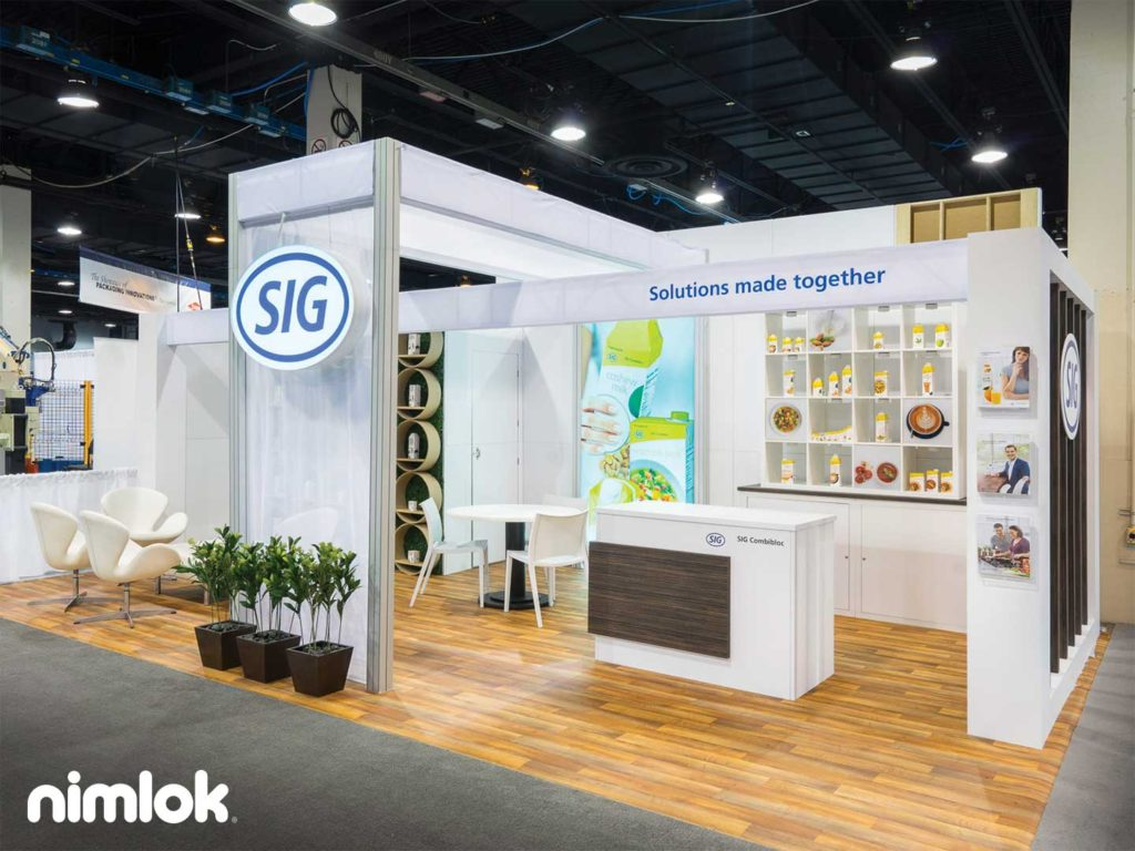15' x 25' trade show exhibit designed by a trade show booth design company with bright white graphics and open space.