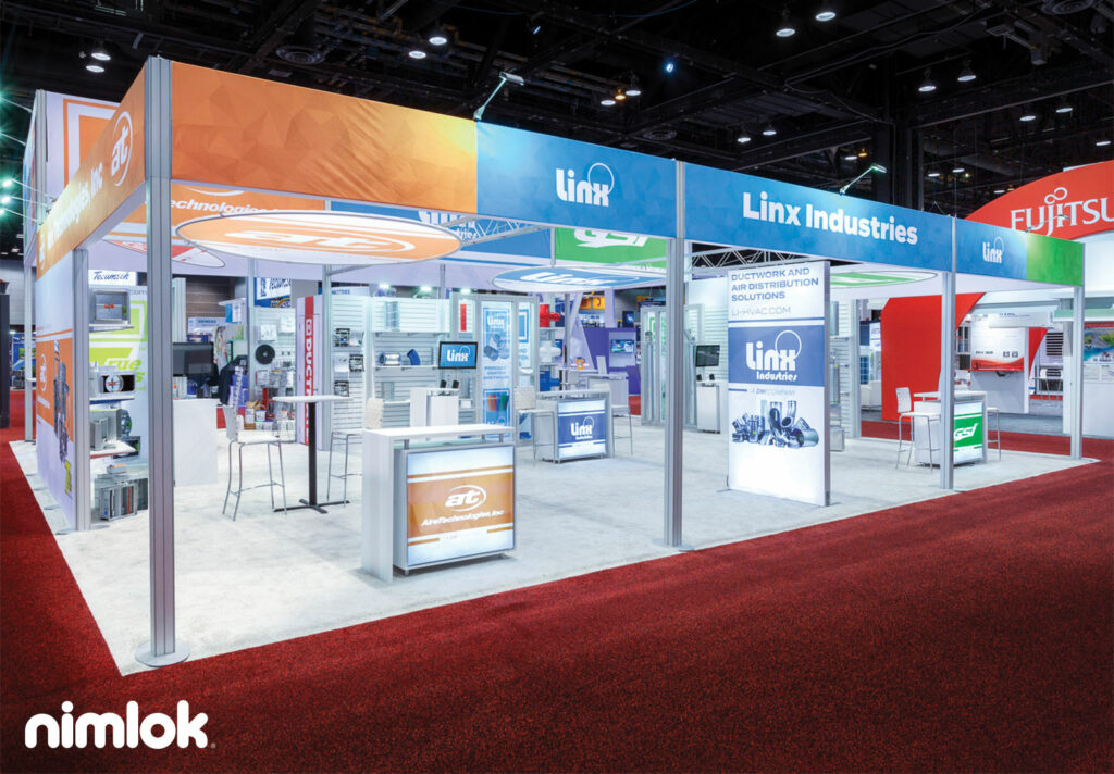 Trade show booth with bright vibrant graphics showing trade show sponsorship options for giveaways at booth.